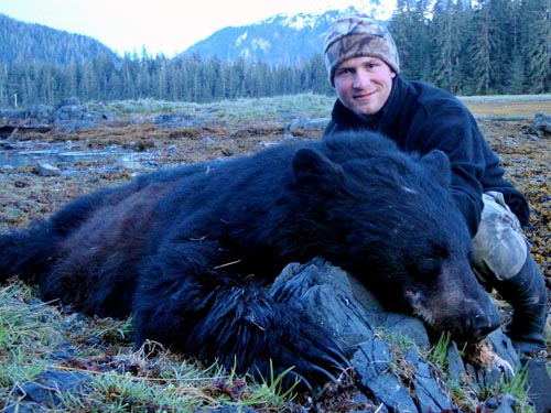 I took this bear just up the bay from camp one night. My first AK black bear - as we stood over him admiring him, I looked inland and spotted Ken's bear. I had to take these pics myself as light was fading fast.